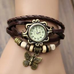 Reloj vintage con mariposa.